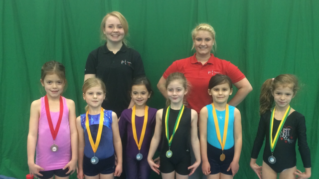 Georgie, Katie and their medal winning gymnasts